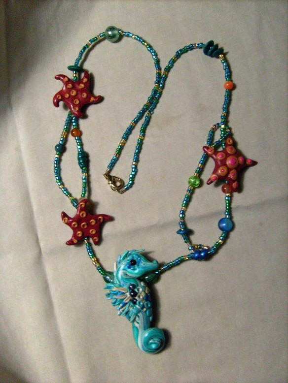 Picture of necklace with seahorse and starfish